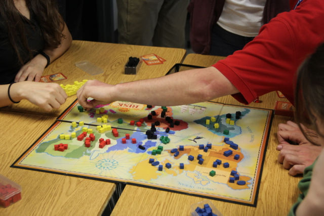 Students play board games as an interactive way to learn history.
