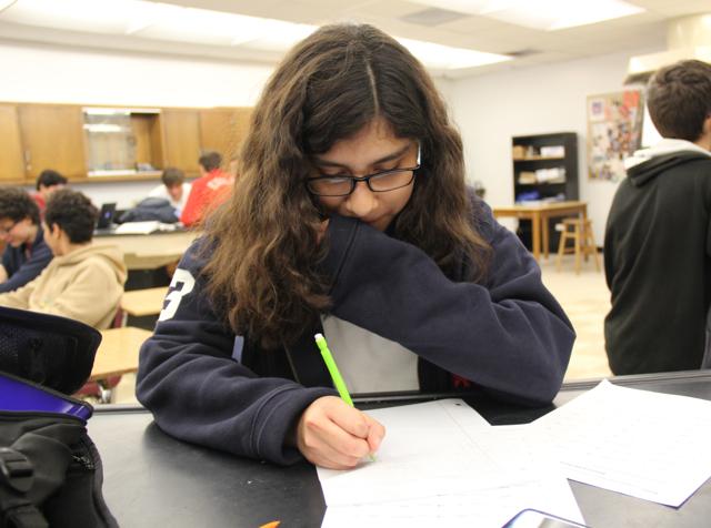 Angie+Villalobos+doing+her+schoolwork.+
