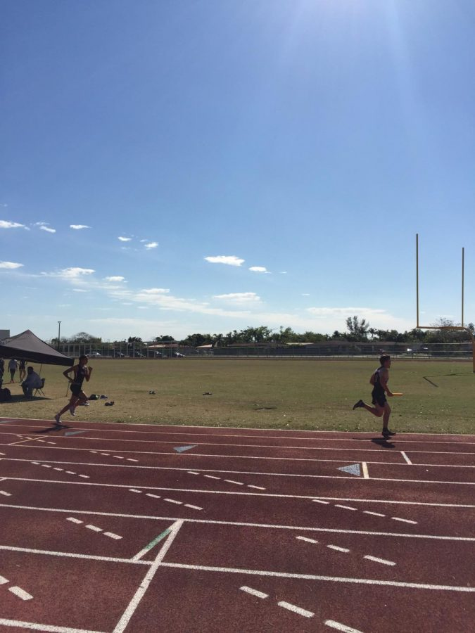 Gables competes versus Miami Sunset Senior High School in the 4x400 relay.
