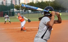A Lady Cavalier hitter awaits an incoming pitch.