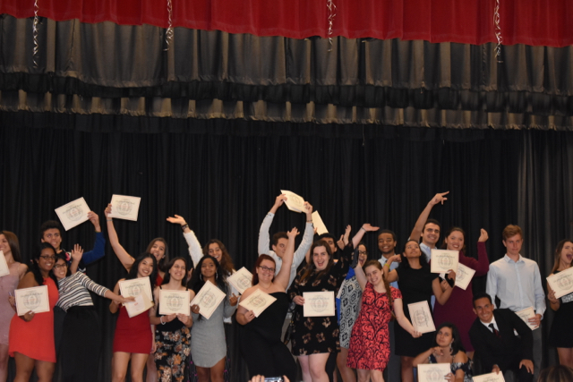 Seniors+celebrate+after+receiving+their+awards.