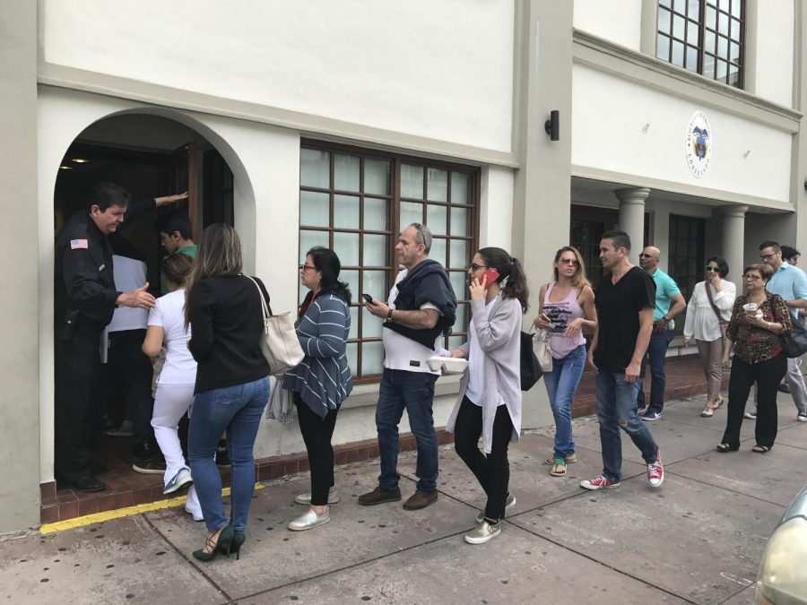 Colombian citizens stand in line outside the consulate, waiting to register as voters for the Colombian presidential elections.