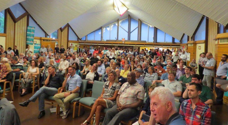 The crowd settles down as the debate begins.