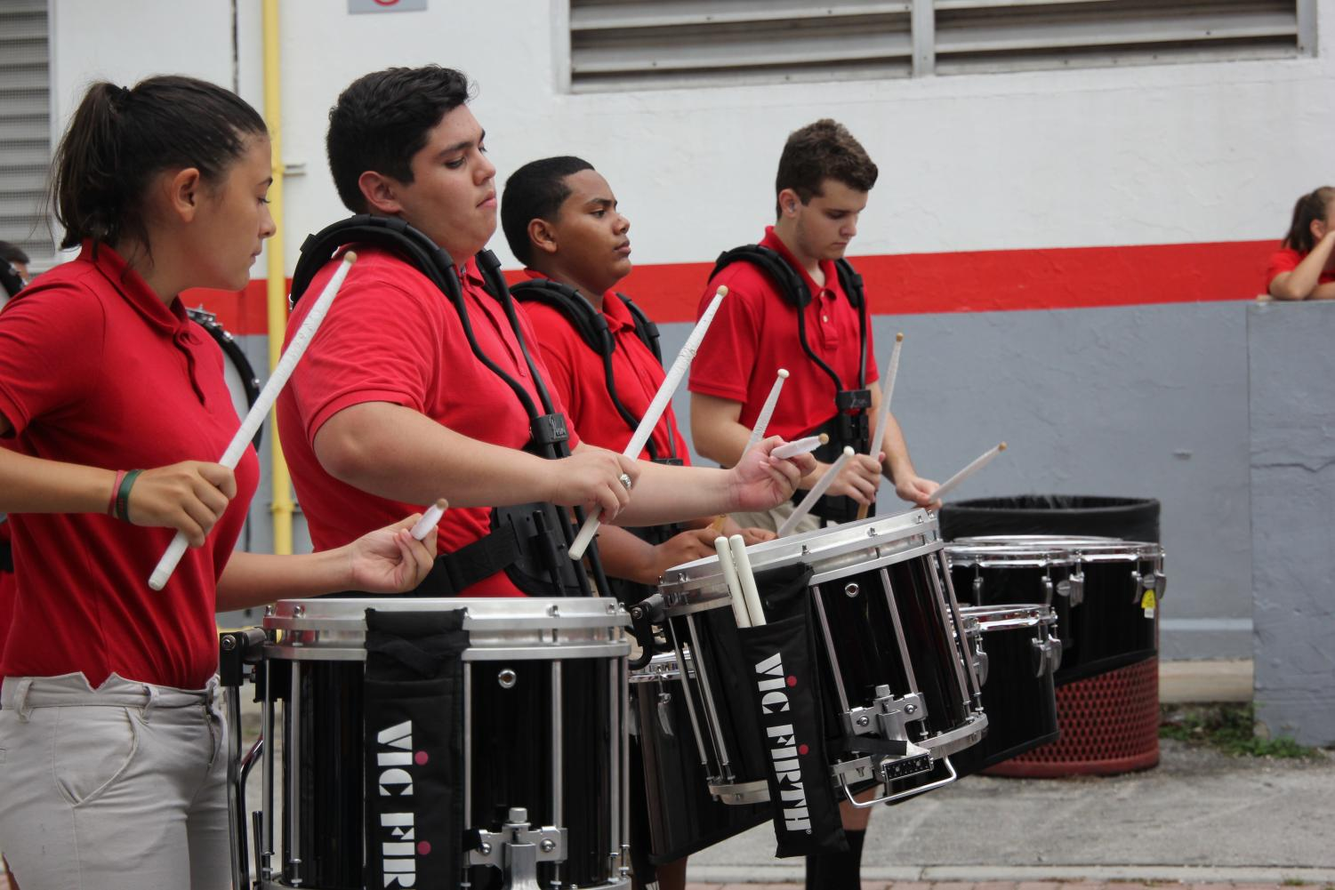 The+Band+of+Distinction+playing+a+killer+beat+to+assist+Gables%27+cheerleaders%2C+Gablettes+and+Color+Guards.+