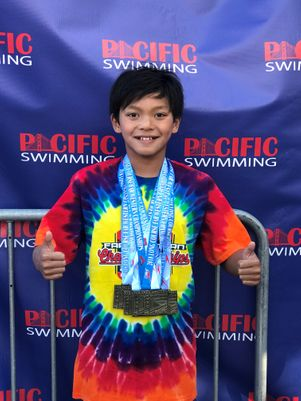 Kid Superman Swims Past Michael Phelps's Record