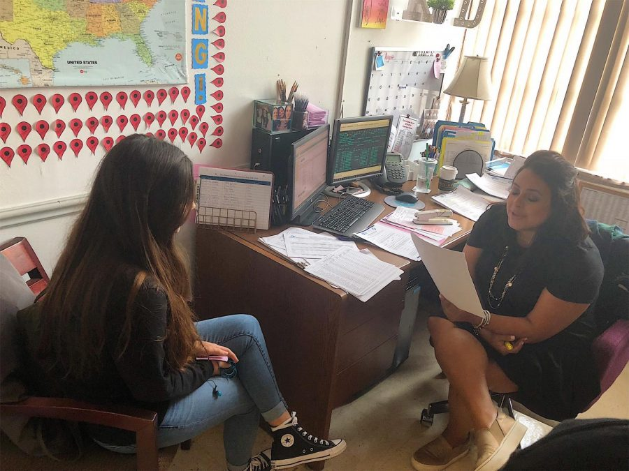 Counselor Ms. Driver guiding a student on mental health.