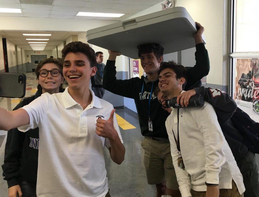 Alexander Sutton takes his 248th selfie alongside his friends.