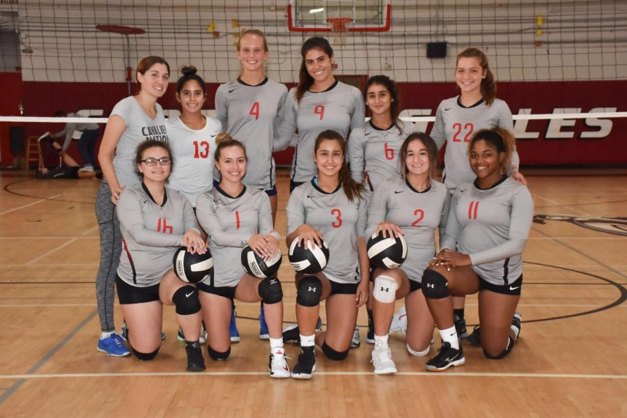The Coral Gables Senior High Girls volleyball team poses for a team photo at he beginning of the season.