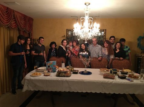 Amy Kaplan celebrating Hanukkah with her family.