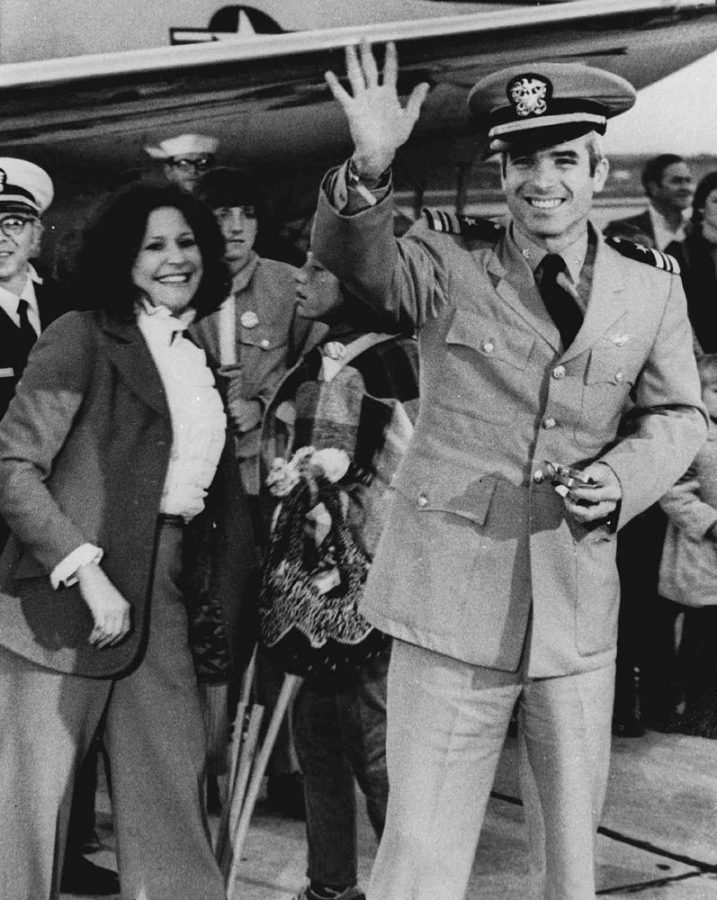 John McCain, then a Lieutenant in the Navy, waves on to a group of people welcoming him back in 1973 from his 5-year internment in a Vietnamese camp.