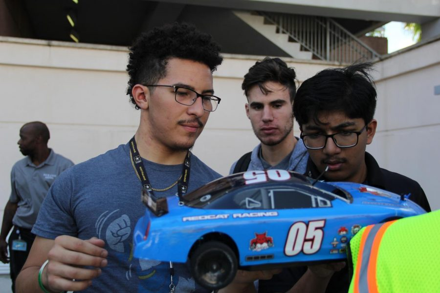 Coral Gables Senior High School students prepare to enter their plastic bottle car in the SECME competition.