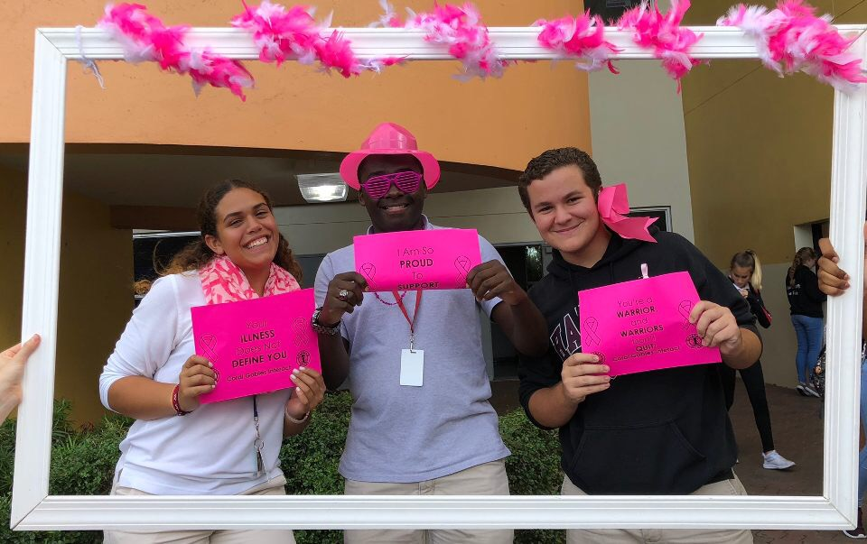Students take pictures while taking part in Interact Pink Week