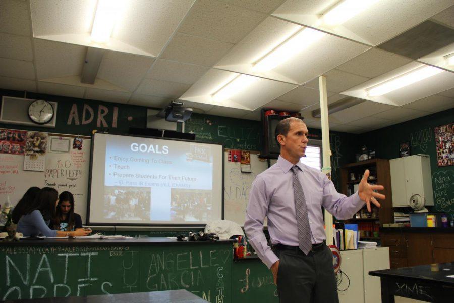 Biology teacher Eric Molina introduces parents to his classroom structure.