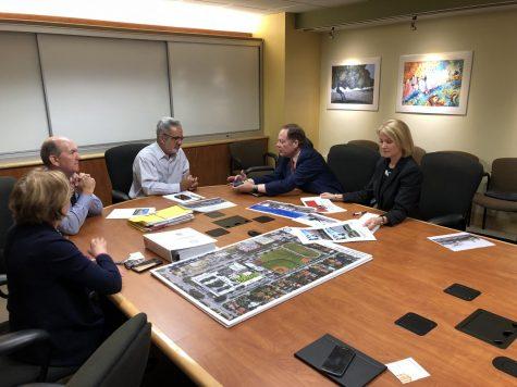 June Morris, Allen Morris, Jaime Torrens, and Victor Alonso collaborating on renovation plans for Gables High.