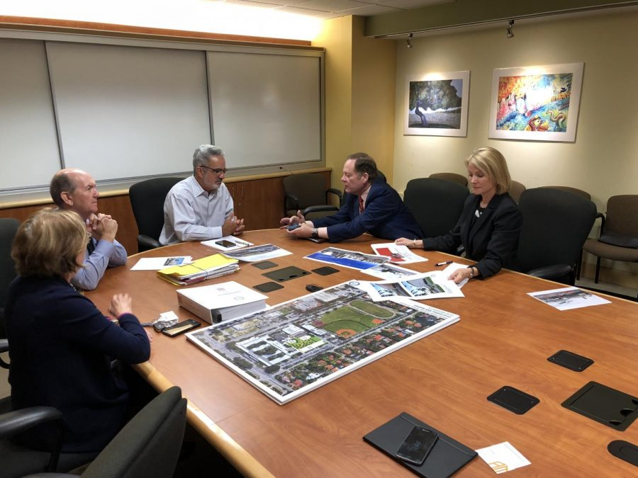 June Morris, Allen Morris, Jaime Torrens, and Victor Alonso collaborating on renovation plans for Gables High.