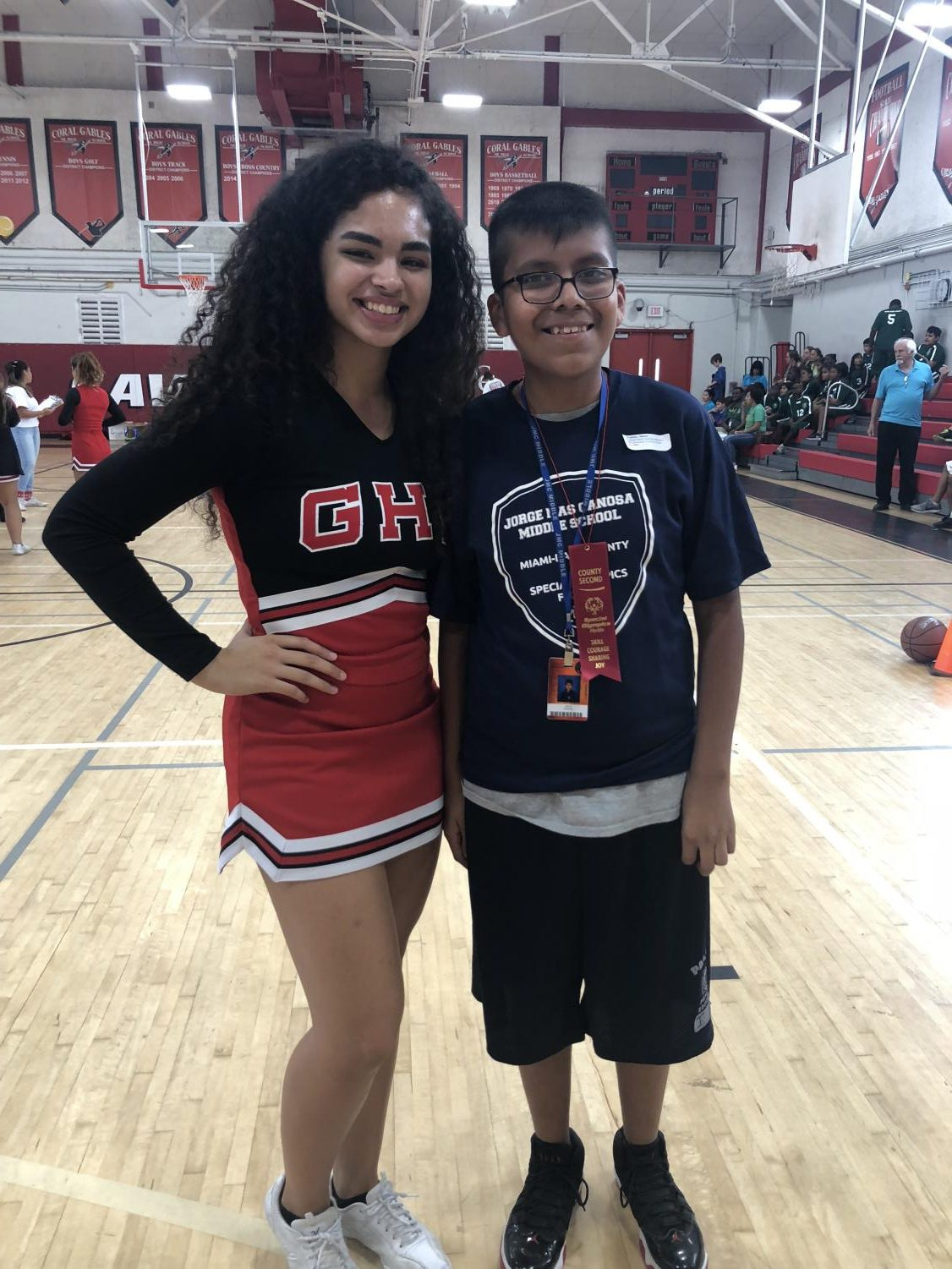 Cheerleader Melissa Rodriguez stands with eighth grader Jesus Franco from Jorge Mas Canosa Middle School at the Basketball Competition.