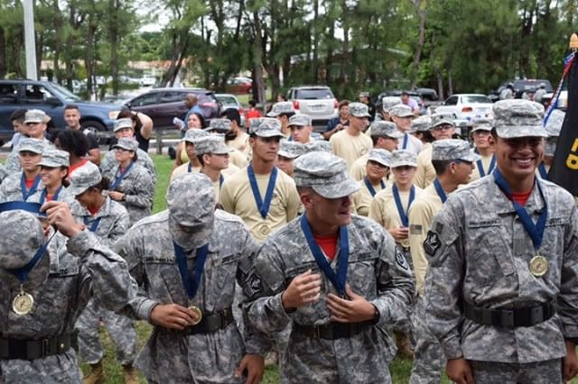 The+male+Raider+team+is+awarded+their+medals.+