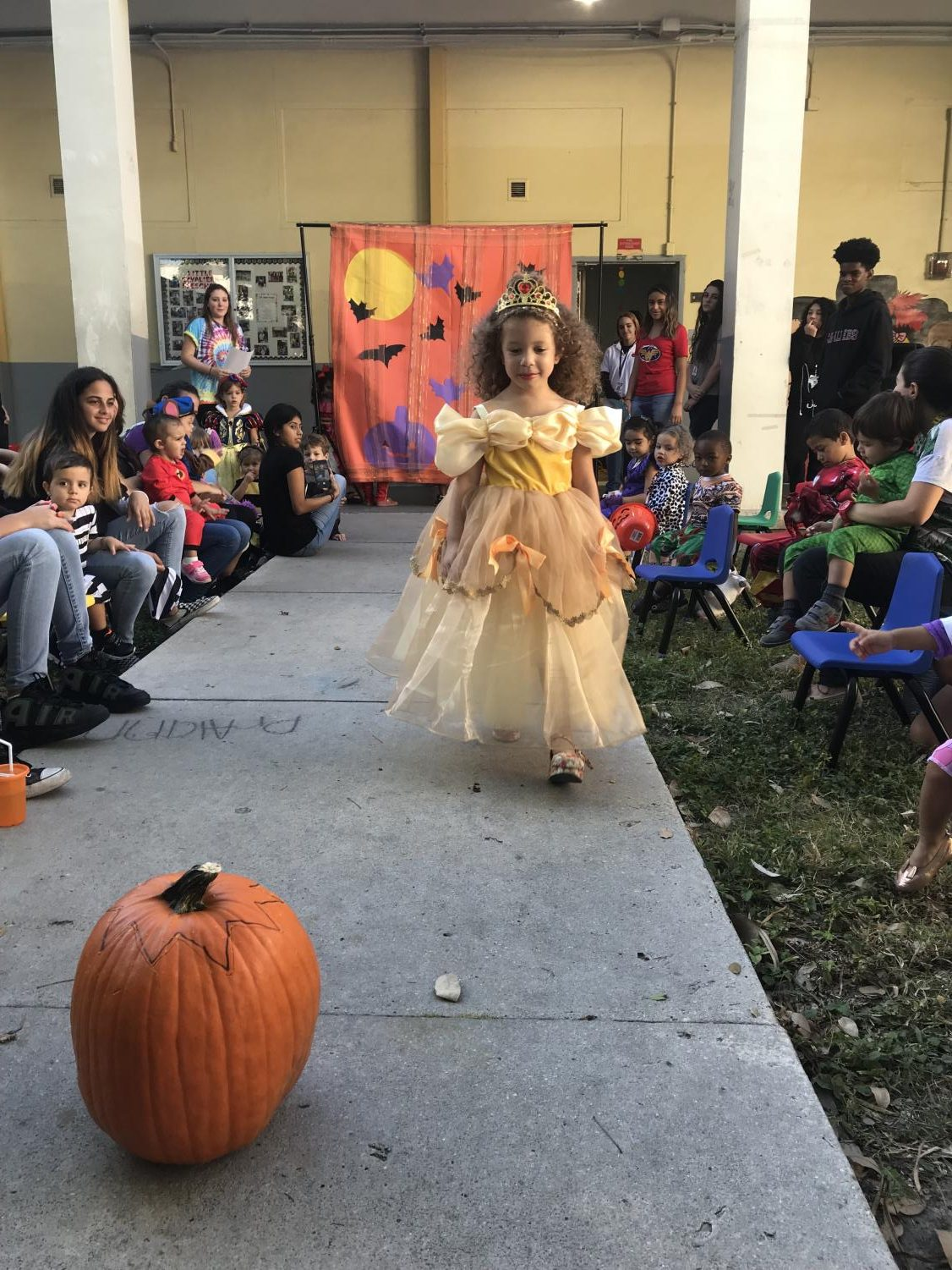Little+Cavalier+showing+off+her+Belle+costume+at+the+Halloween+Fashion+show.
