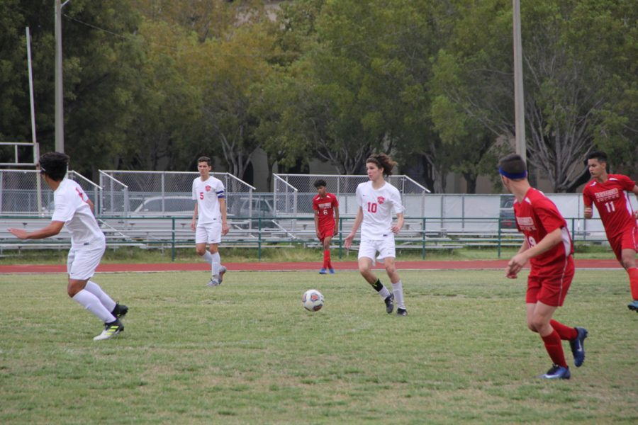 The Boys Soccer team charges up the field on offense.