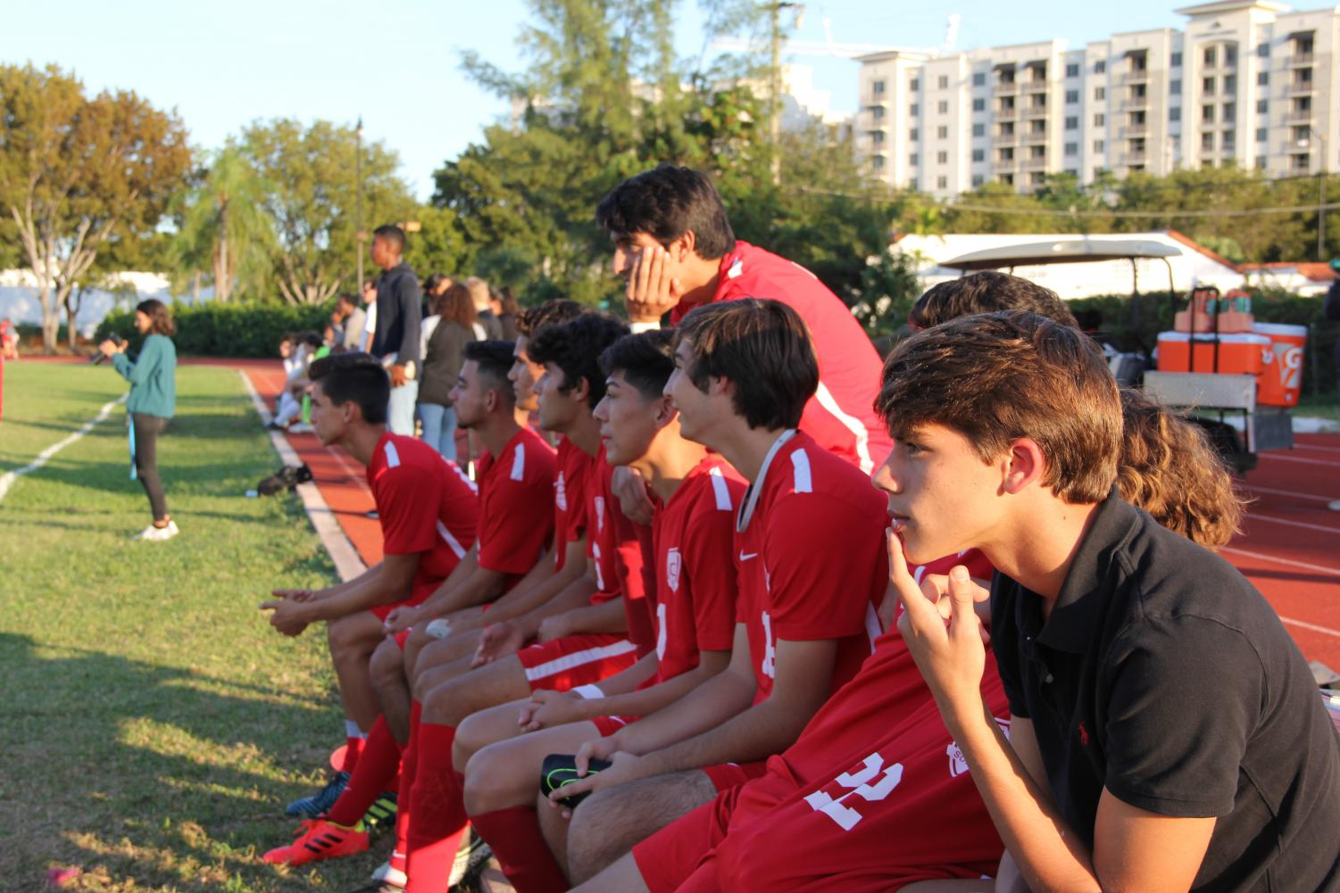 Cavalier Soccer players watching their teammates play from the sidelines.