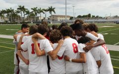 The Cavalier soccer team huddling in unison to kick-start a game