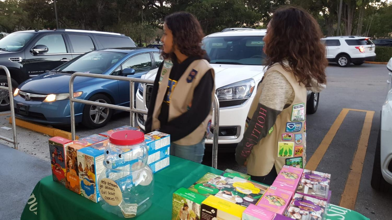 Girl scouts selling cookies to raise money.