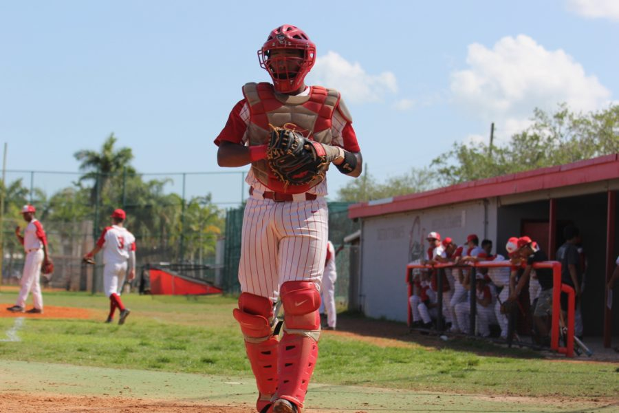 Senior catcher Gerardo Rodriguez approaches the home plate and readies to handle his pitcher.