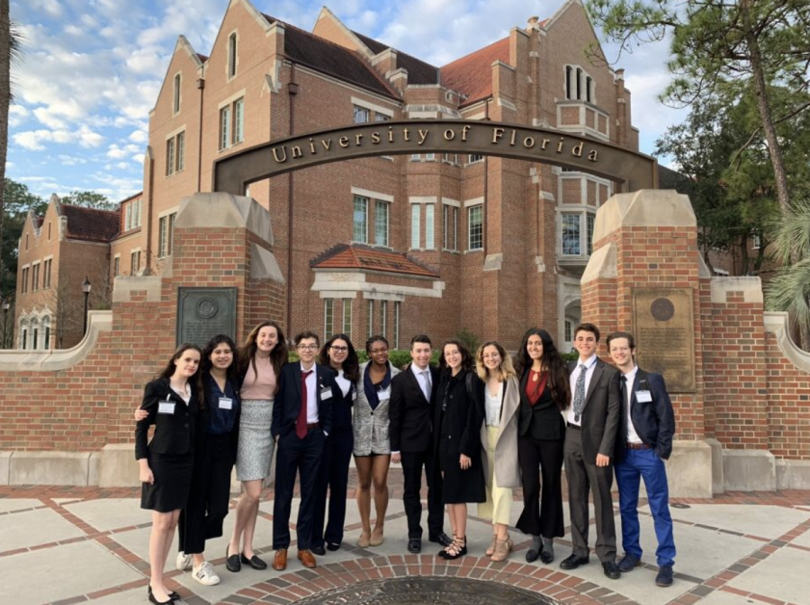 Gables students pose for a picture in front of the UF sign before conference, as per tradition.