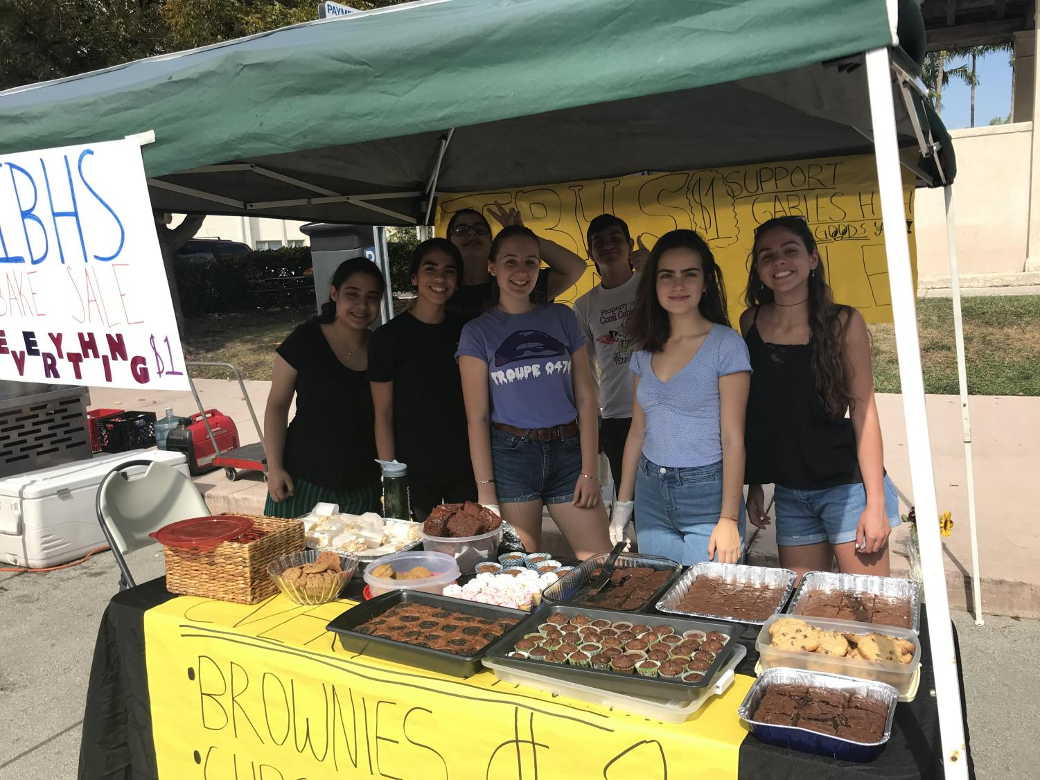 The IBHS board at the Farmer's Market for their bake sale!