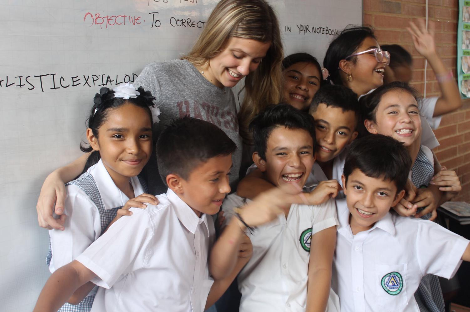 Erwich is pictured here with a group of the young children she met in Columbia.