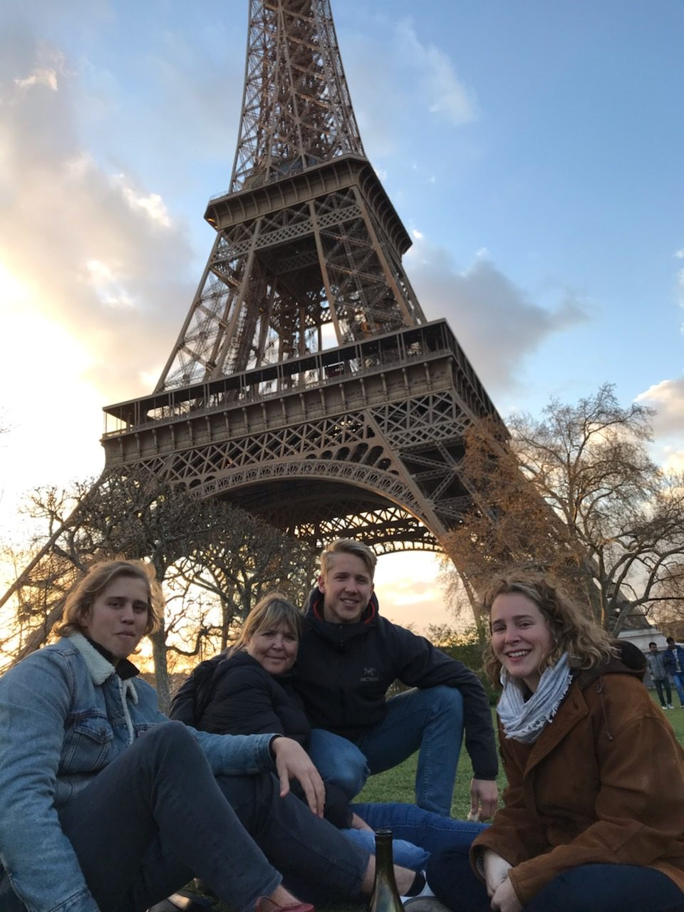 Sutton+sitting+with+his+family+underneath+the+Eiffel+tower.