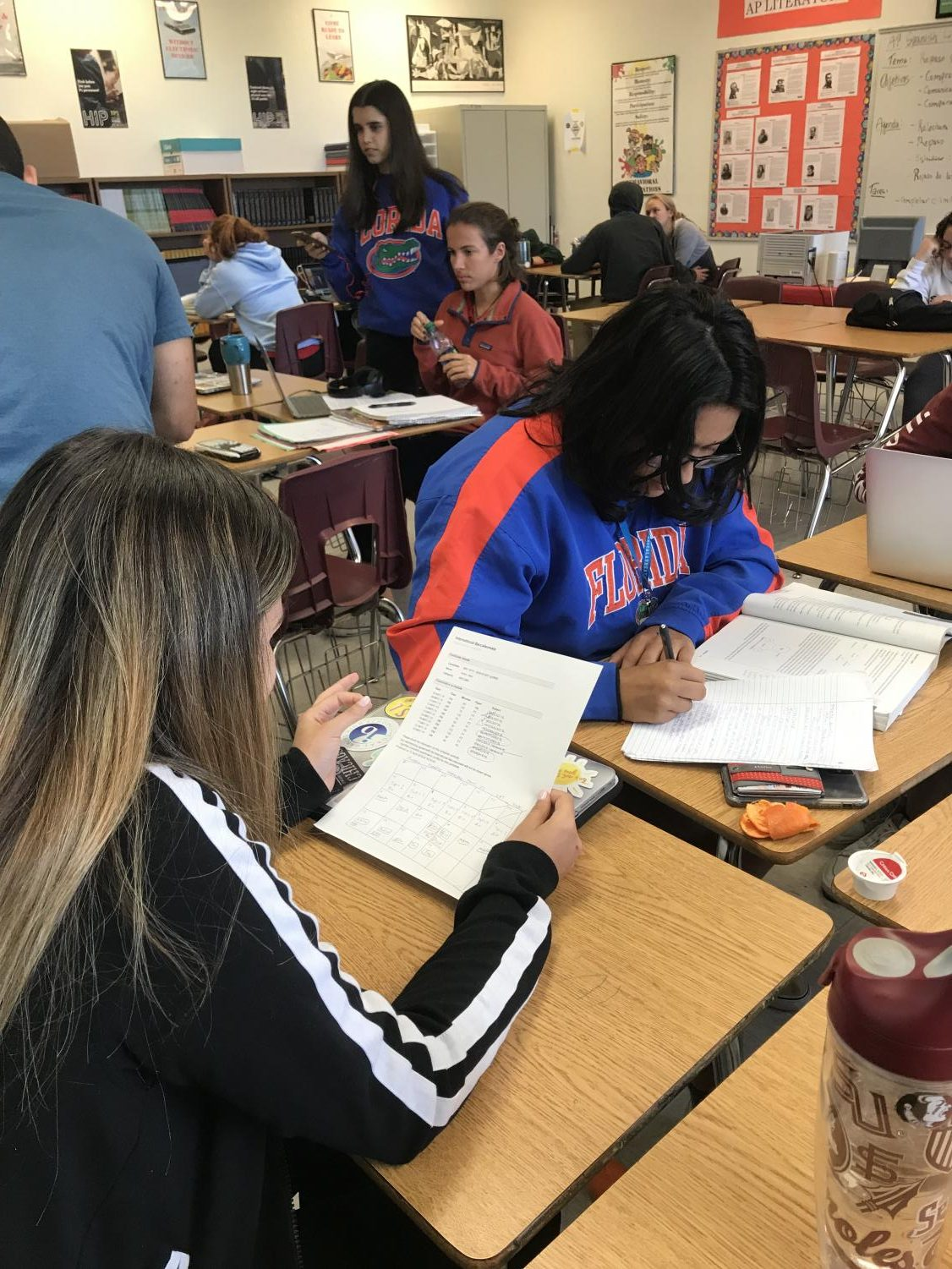 Seniors Camila Torres and Melanie Ezquezabal using their study plans to study for biology.