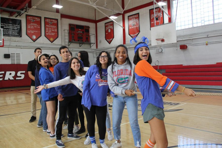 Seniors smile while playing a game of tug of war.