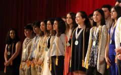 The seniors receiving Summa Cum Laude stand proudly during the awards ceremony.