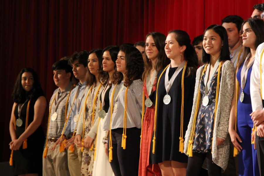The+seniors+receiving+Summa+Cum+Laude+stand+proudly+during+the+awards+ceremony.