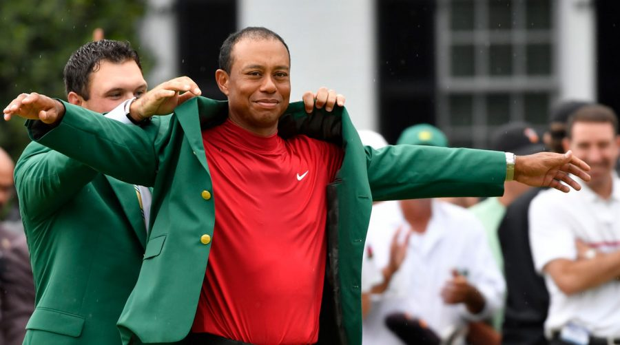 Golfing legend Tiger Woods receives his fifth green jacket after winning the 2019 Masters tournament.