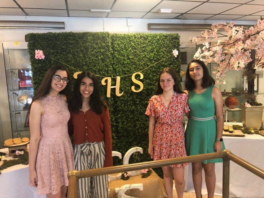 NHS board member Lia Sanchez, Mindy Miranda, Ellie Morris and Isabel Jaen pose for a picture after induction.