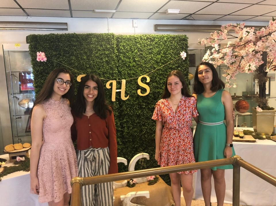 NHS board member Lia Sanchez, Mindy Miranda, Ellie Morris and Isabel Jaen pose for a picture after induction.