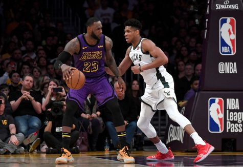 LeBron James (left) of the Los Angeles Lakers backs down Giannis Antetokounmpo (right) of the Milwaukee Bucks