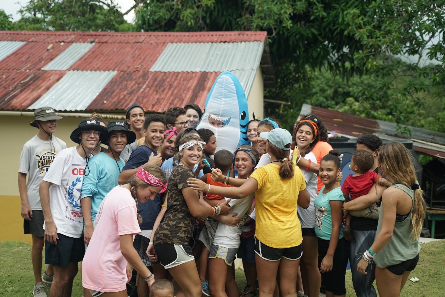 BLUE+Missions+volunteers+celebrate+their+accomplishments+and+embrace+their+Dominican+friends.