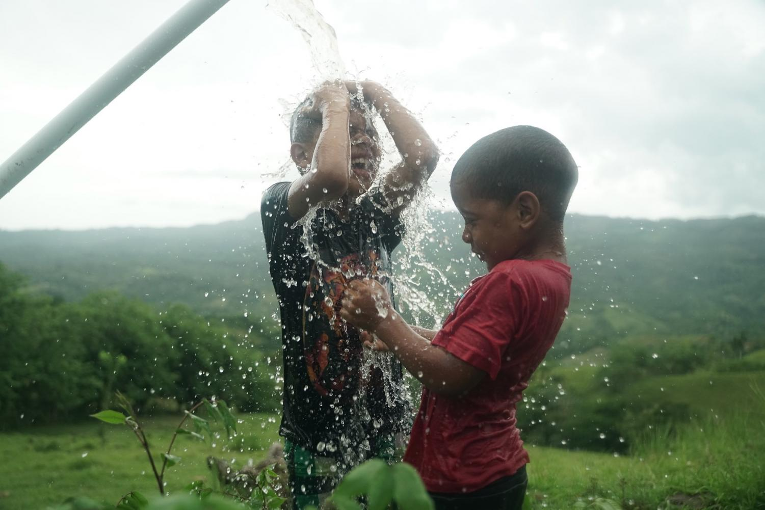 The+children+of+the+Dominican+Republic+celebrating+the+long-awaited+arrival+of+water+day.