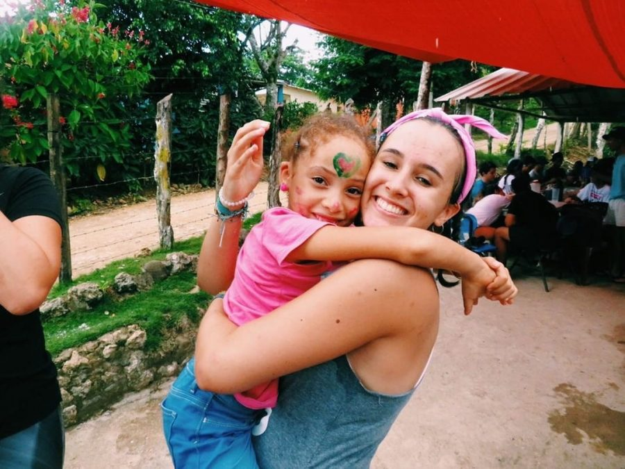 Alexandra Torres embraces and carries her new friend in the Dominican Republic.