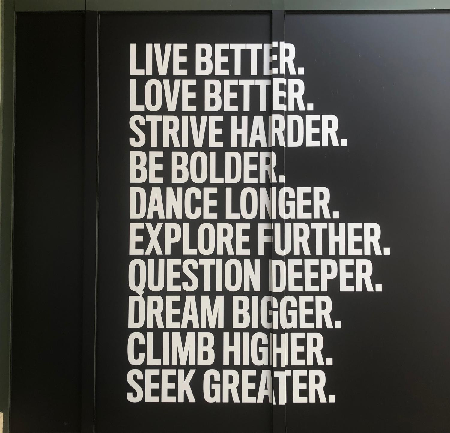 Equinox's exterior walls at Merrick Park display motivational quotes related to success, goal-setting and achievement.