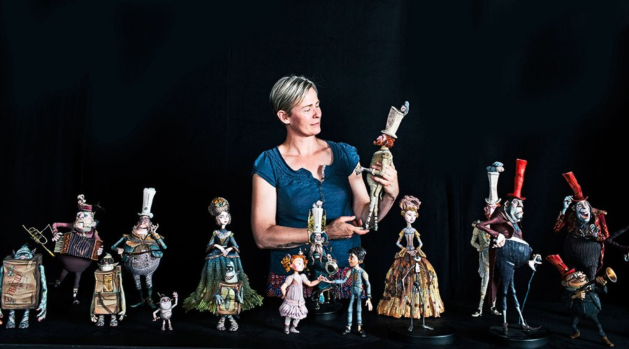 Georgina Hayns, creative supervisor, puppet fabrication, with the cast from