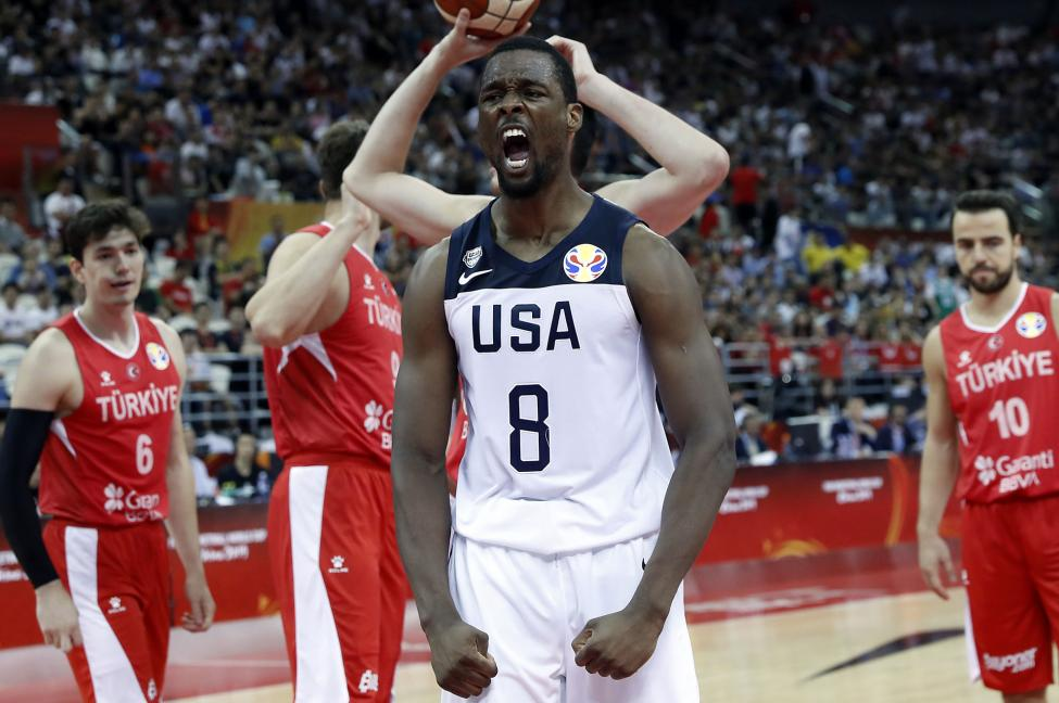 Harrison Barnes pridefully celebrates after an emphatic dunk against Turkey.