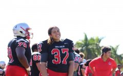Junior Arianna Gonzalez stands alongside her teammates during practice with the junior varsity Cavalier Football team.