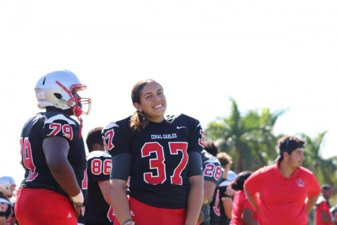 Junior Arianna Gonzalez stands alongside her teammates during practice with the junior varsity Cavalier Football team.