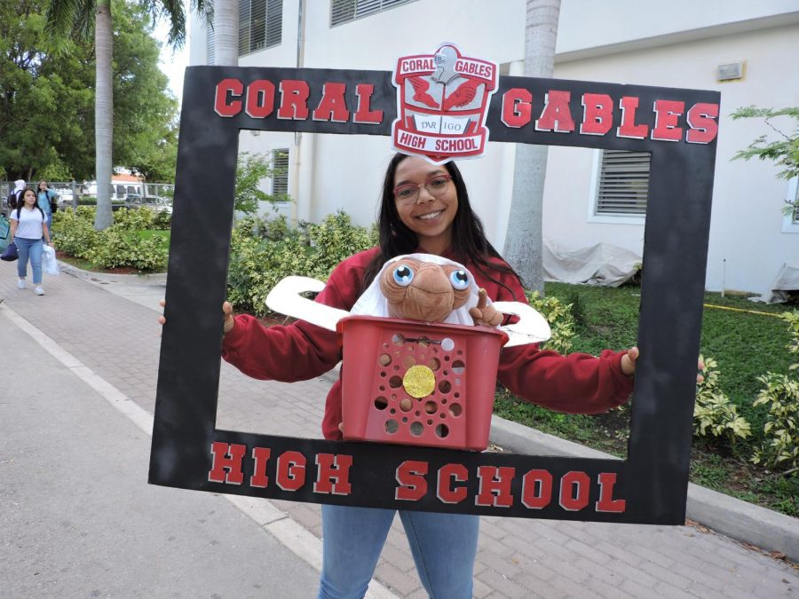 Senior Isabella Quintanilla poses for a picture with a Cavalier picture frame during Spirit Week.