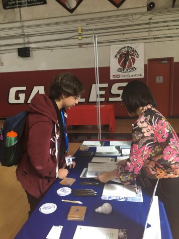 A cavalier student converses with a representative from IE University during the on-campus college fair Oct. 11.