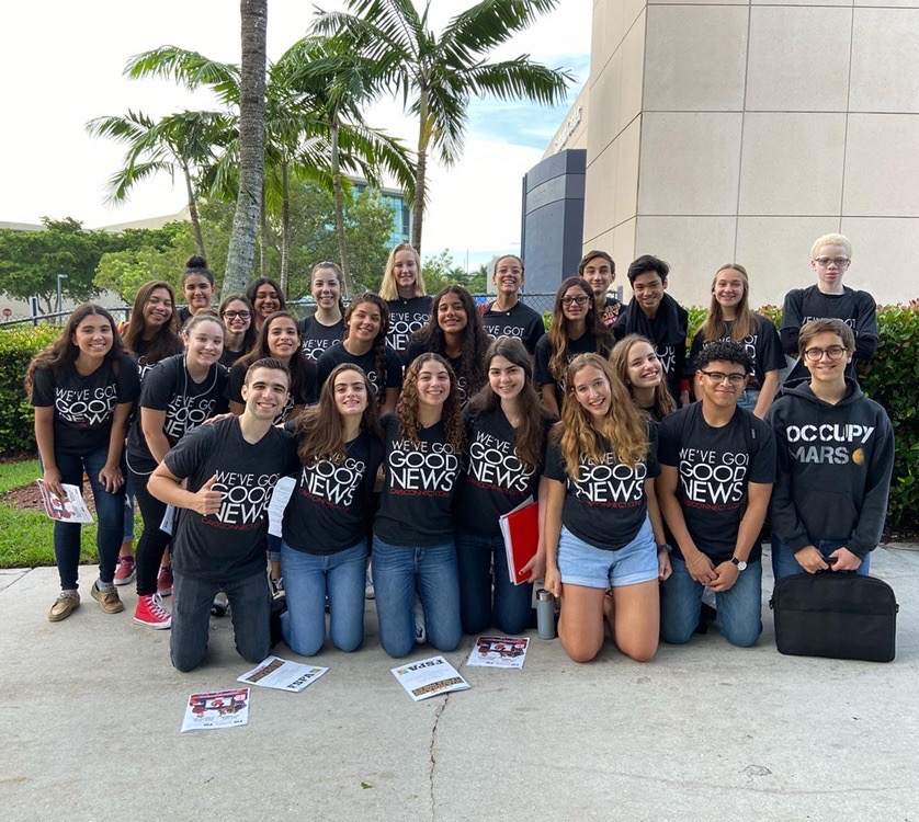 The CavsConnect staff smiles in front of the FIU Graham Center, where the 2019 Journalism Day convention was held.